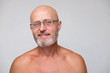 portrait of adult bearded bold skinhead grizzled man in eyeglasses on white