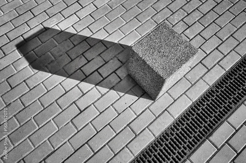 Black and white picture of a street and concrete block on pavement, abstract urban background. - 168452070