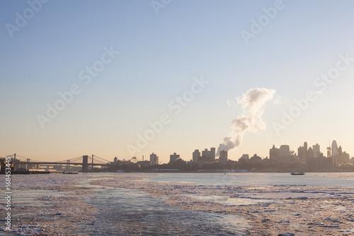 Foto op Canvas Brooklyn Bridge NYC Skyline & Brooklyn Bridge viewed from a rare frozen Hudson River during the winter Polar Vortex of 2015