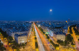 Moonrise over the Champs-Elysees in Paris at nightfall