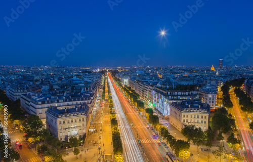 Wall mural Moonrise over the Champs-Elysees in Paris at nightfall