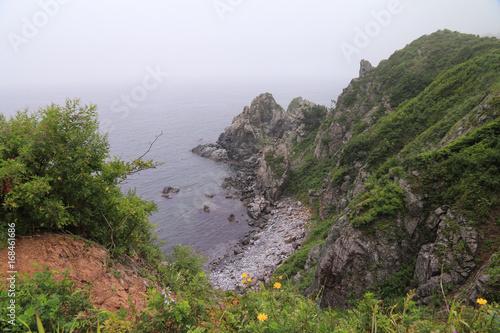 Wall mural Foggy sea scape. Rocky shore. Gamov Peninsula, Shultz Cape, Primorye.