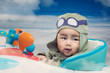 Quadro Baby play on airplane toy on the sky