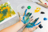 Early childhood education. Dirty little painter. Artist workplace, creative hobby for children, messy artistic background - 168477430