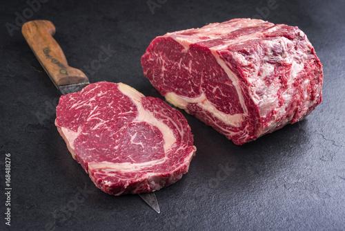 Foto op Plexiglas Steakhouse Raw dry aged Kobe Entrecote Steak as close-up on a slate