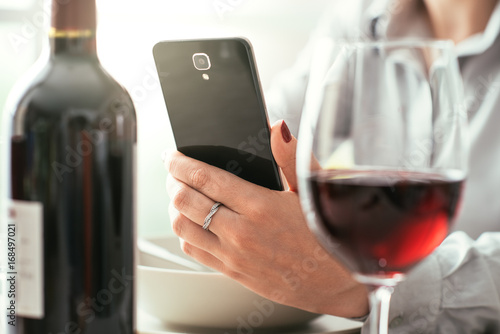 Woman using a wine app