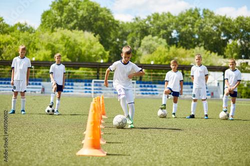 Team of Boys Training for Football Game
