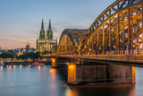 sunset sky with colors and clouds over the city skyline Cologne with Bridge and Köln Dom ,Evening scene over Cologne/Koln city with Kolner Dom/Cathedral behind the Hohenzollern bridge