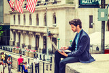 Young Businessman working on Wall Street in New York. poster