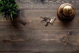 Hotel service bell on dark wooden table top view copyspace - 168517083