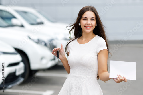 Sticker Smilling woman with keys and agreement on background of car dealership