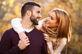 Beautiful couple in love in colorful park - 168528863