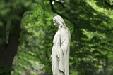 Virgin Mary statue. Vintage sculpture of sad woman in grief (Religion, faith, suffering, love concept) - 168546478