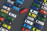 Car is parking in full parking lot. 3D rendered illustration. View from top. - 168555013