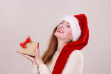 Woman holding gift box. Christmas time