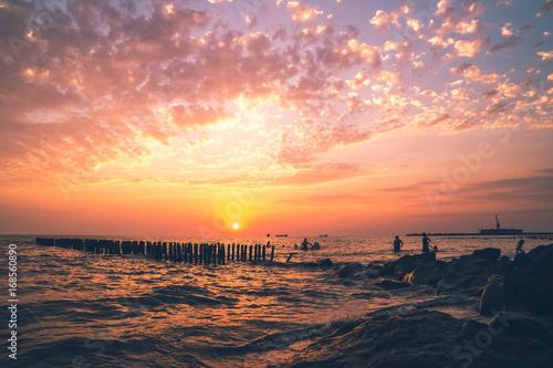 Fotobehang Koraal Beautiful sunset on the Black sea. Gold sea sunset.Poti, Georgia