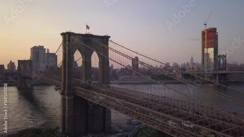 Poster late afternoon flying alongside Brooklyn Bridge towards Manhattan