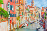 Views of the most beautiful channels of Venice, narrow streets, houses. - 168564861