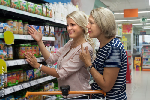 young mother and grandmother in a supermarket