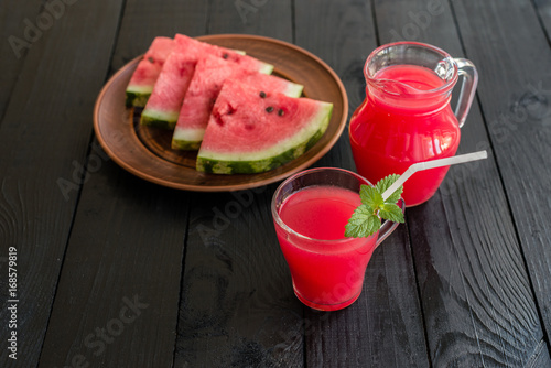 Fotobehang Sap Watermelon juice on a wooden table. It can be used as a background