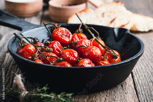 Plakát Roasted cherry tomatoes  in cast iron skillet