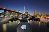Handlebar of a motorcycle in the foreground in front of the city of Manhattan © alcatrax1981
