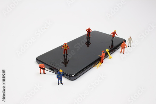 tiny worker on mobile phone Poster