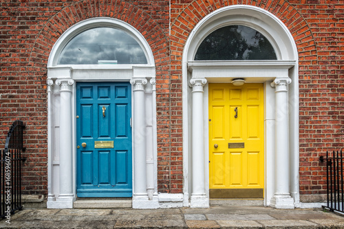 Blue and yellow classic doors in Dublin, example of georgian typical architectur Poster