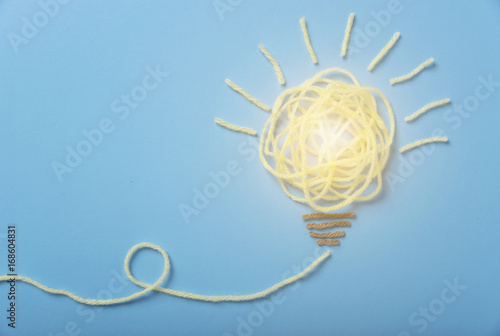 yarn light bulb, concept of new ideas with innovation and creativity.
