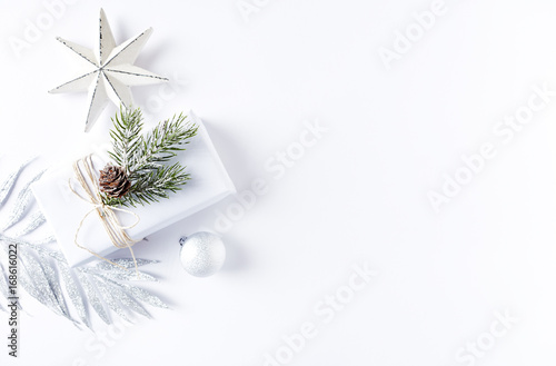 An Arrangement of Christmas Decorations and a Gift Box Poster
