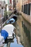 Boats docked at Venetian Canal, Venice, Italy