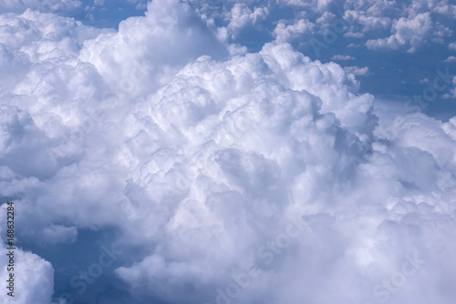View of blue sky above the clouds from airplane window - 168632284