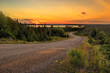 Winding country road sunset