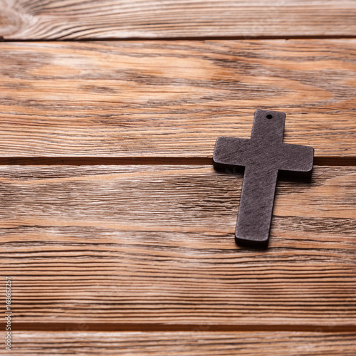 Old cross on a brown wood - 168667257