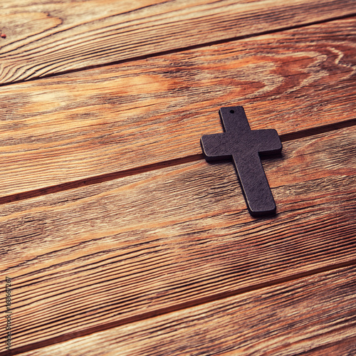 Old cross on a brown wood - 168667267
