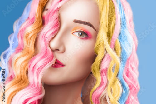 beautiful woman wearing in colorful wig Poster