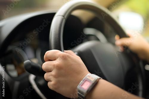 Female driving car on blur filter. плакат