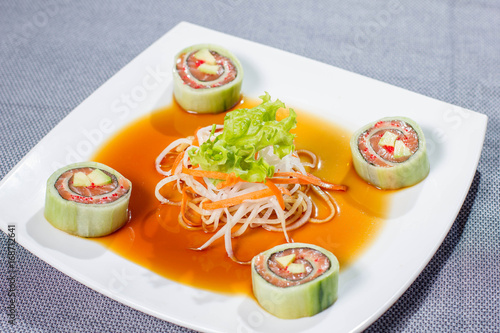 Sushi with salmon, avocado, soft cheese and salad Poster