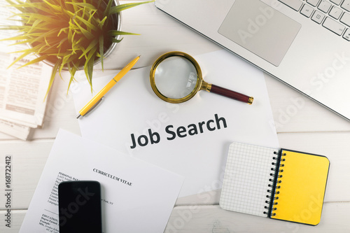 Foto Murales job search items on white table. top view