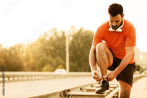 Poster Man exercise on the bridge