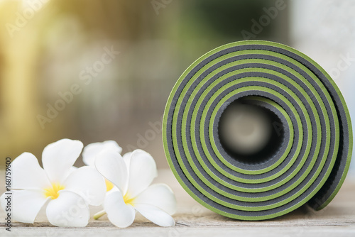 green yoga mat and a flowers