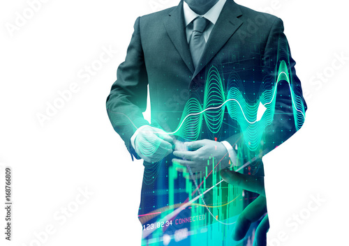 Double exposure businessman with stocks and shares. Investing background.