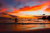 Colors at sunset in the ocean with wooden boats in the sea of the tropical island of Boracay in the Philippines