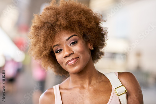 portrait of happy african american woman at airport ready to depart for flight - 168812881