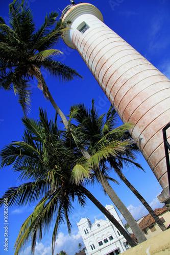 Aluminium Donkerblauw Lighthouse in fort Gale at Sri Lanka seascape