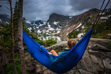 Woman relaxes on a hammock lake Isabelle Colorado - 168822086