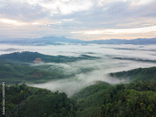 Poster Landscape of misty mountain forest covered hills at khao khai nui