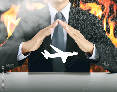 businessman and airplane with fire background, insurance concept
