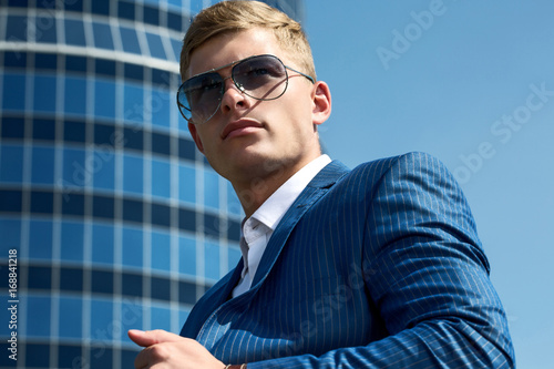 Plakát Portrait of handsome businessman in an urban setting