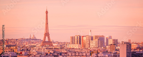 Panoramic skyline of Paris with the Eiffel tower at sunset, Montmartre in the background, France and Europe city travel concept - 168847276
